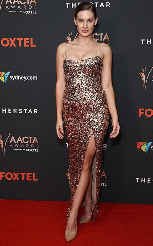 What's a red carpet without a serious serving of sparkle? Actress Bronte Bailey's metallic gold frock certainly delivers on the shimmer and shine front.