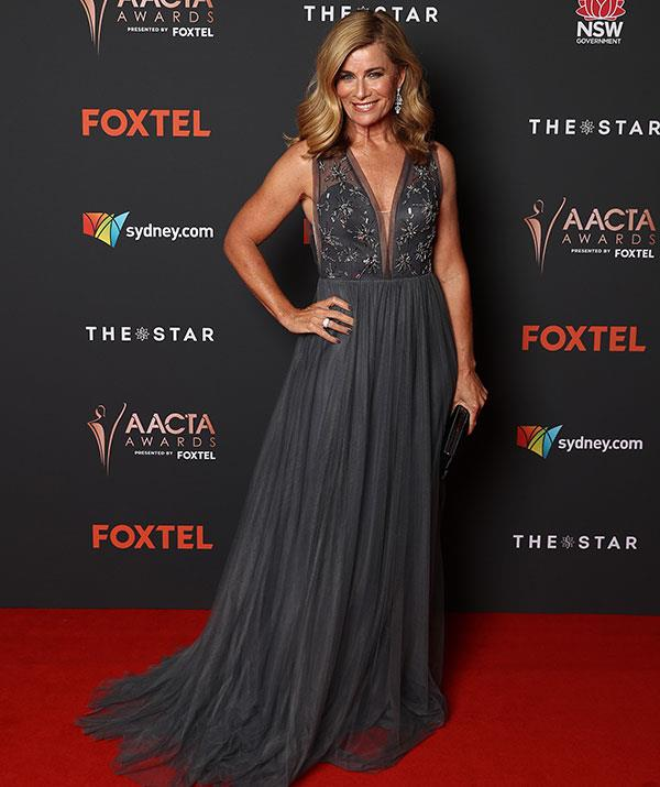Dripping in diamonds, Best Presenter nominee Deborah Hutton brings her A-list fashion game in this plunging Pronovias gown.