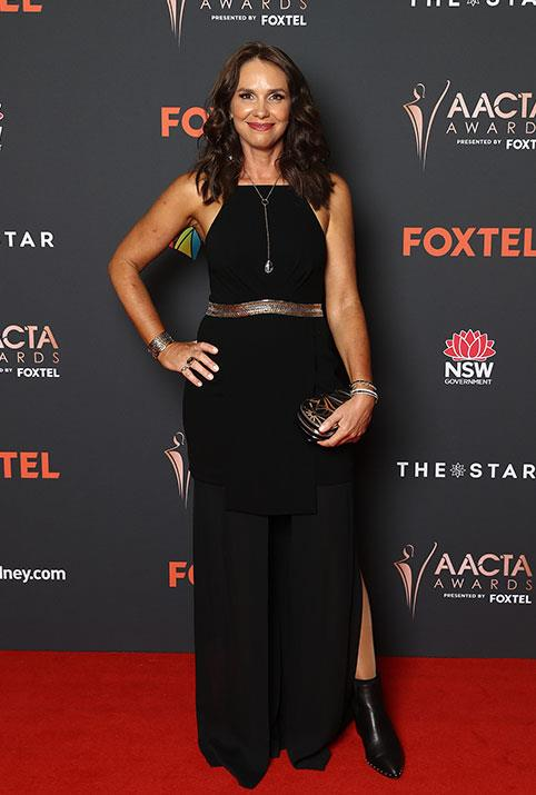 Best Guest or Supporting Actress nominee Tasma Walton stuns in a bohemian style black dress but it's the ankle boots which give it a tough twist.