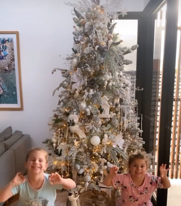 **Candice Warner**<br> The *SAS Australia* star's daughters were jumping for joy over their gorgeous tree.
