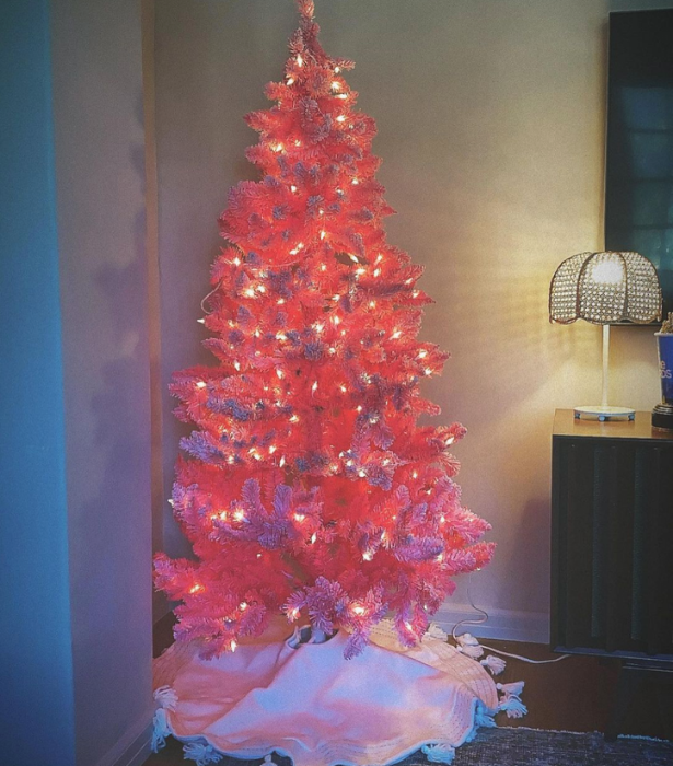 **Ashley Tisdale**<br>We feel like Ashley Tisdale took a fashionable leaf out of her High School Musical character, Sharpay's book for Christmas this year, opting for a hot pink tree.   Not pink decorations. A pink tree.   Simply with adorned with fairy lights, its strikingly familiar to Khloe Kardashian's tree from 2019.