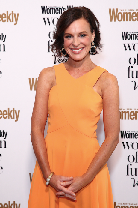 TV host Natarsha Belling went bright and bold in this orange design.