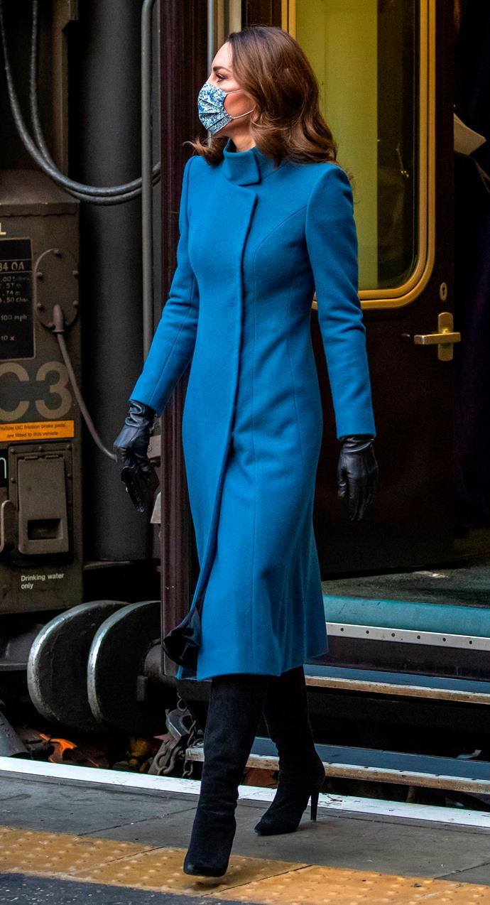 Kate looked chic in a knee-length Catherine Walker coat, accessorised with a Strathberry wallet.