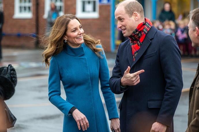 The Duke and Duchess engaged in animated conversation with members of the school community.