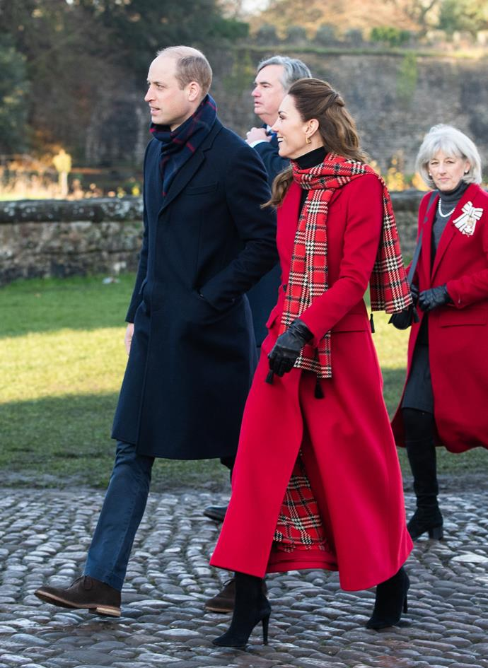 On their second full day, Kate and Wills kick started things with a visit to Cardiff castle. Kate wore a very festive ensemble consisting her favourite bright red Alexander McQueen coat and red tartan scarf and skirt.