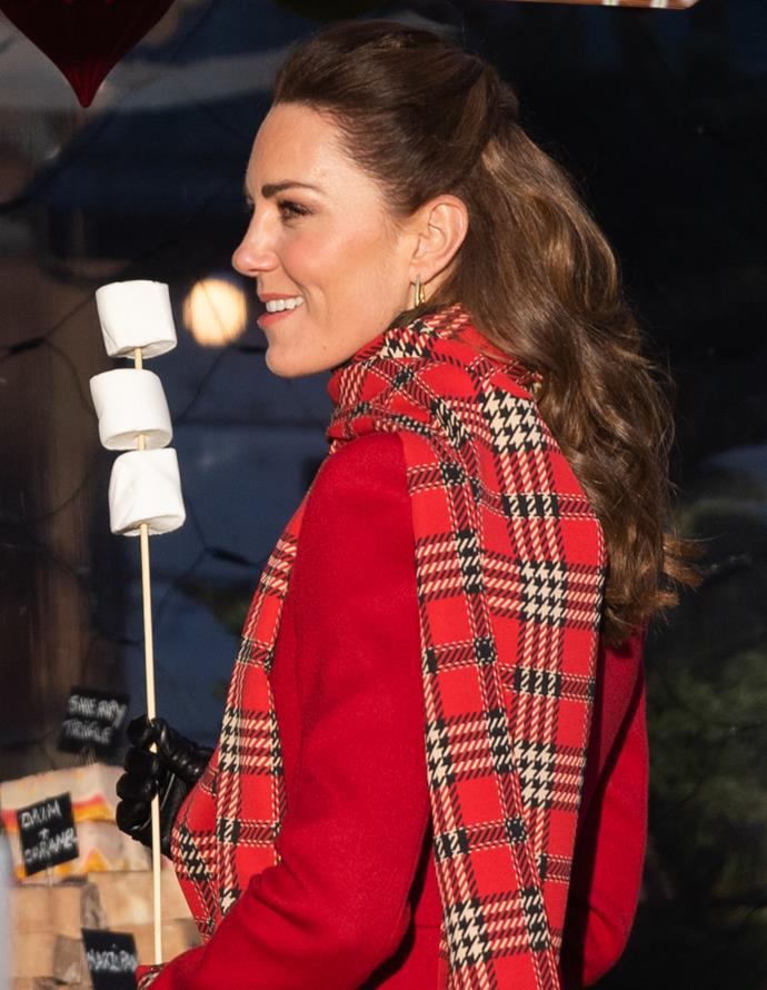 The Duchess got extra cosy with some marshmellow roasting, but not before we got to enjoy our favourite part of her entire outfit for the event.
