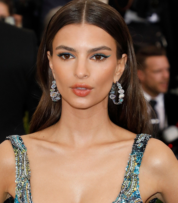 "**Line it up** <br> If you're wanting a more subtle nod to the festive season try working with a colouful eye pencil or liner. Opt for a season red, green or gold, mix or match like Emily Ratajkowski or match the hue to your outfit. For a bold approach you can use the coloured liner alone or for a more subdued look draw above your usual black liner.<br><br> **Try**: FENTY BEAUTY [Flypencil Longwear Pencil Eyeliner](https://www.sephora.com.au/products/fenty-beauty-flypencil-longwear-pencil-eyeliner/v/cuz-i-m-black?q=glitter%20eyeliner|target=""_blank"")."