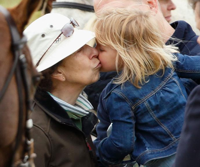 Pucker up! Doting grandmother Princess Anne shares a precious moment with Mia, six.