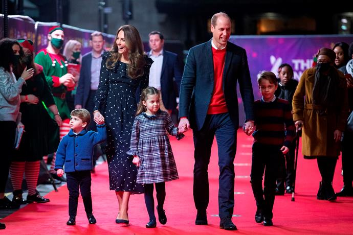 The royals walked the red carpet hand in hand.