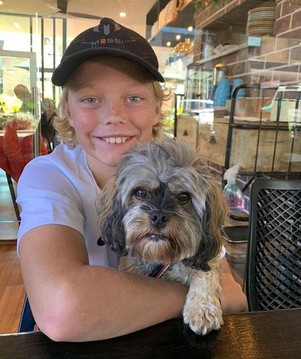 While proud mum Bec shared this adorable photo of her son with their pooch Bux.