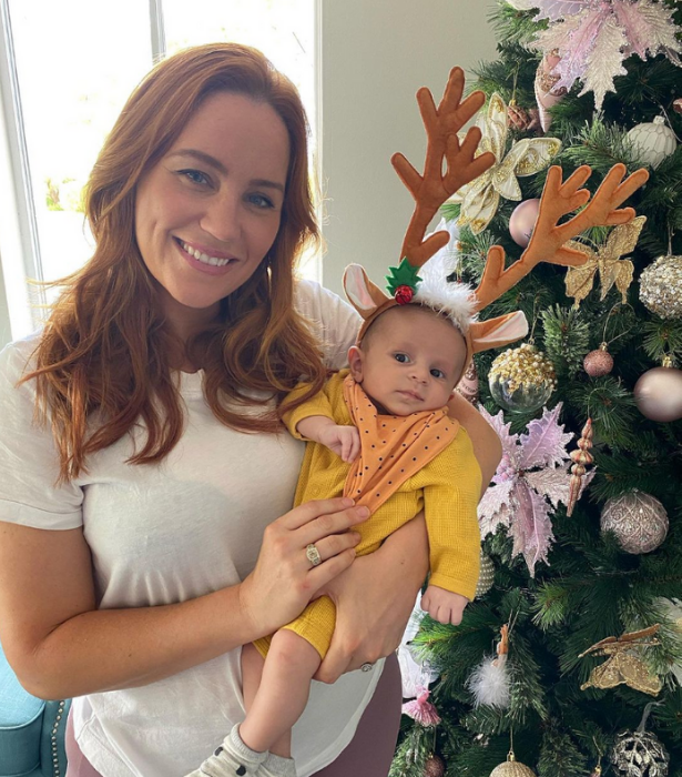 **Cam and Jules Merchant**<br>  It may be just a brief glimpse of their tree but that's okay because we're way too distracted by how cute baby Oliver looks in his reindeer outfit!