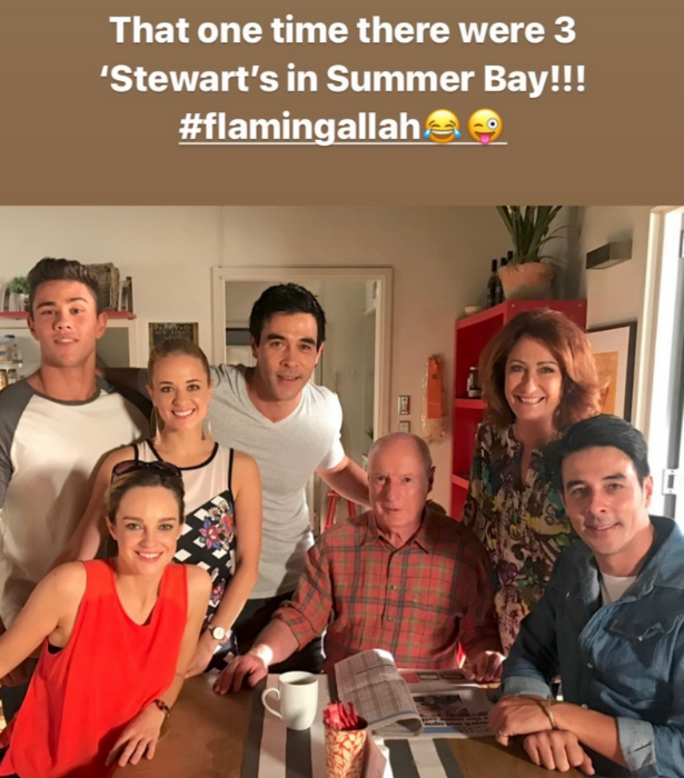 Seeing double! Nick, on the far right, with some of the *Home And Away* cast and brother James behind Ray Meagher.