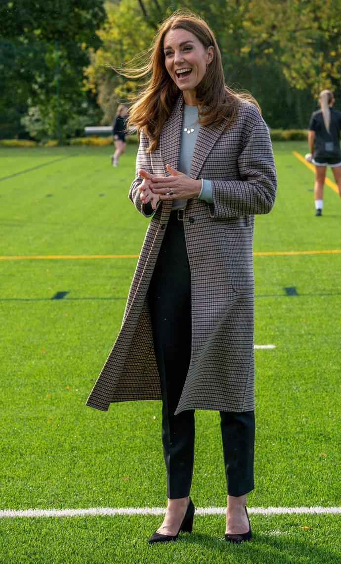 On a visit to the University of Derby, Kate beat the chilly weather in this gorgeous Massimo Dutti coat. Given the October timing, we despairingly lamented the idea of wearing beautiful woolen coats as the weather heated up Down Under.