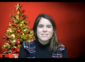 Eugenie opted for a festive tartan ensemble in her latest video.
