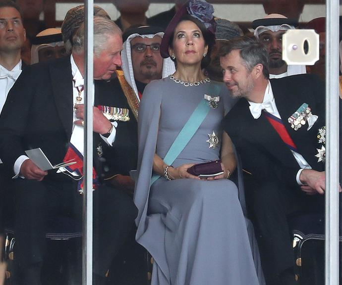 Caught in the middle: Princess Mary shows off her best poker-face as Charles and Fred chat over her.