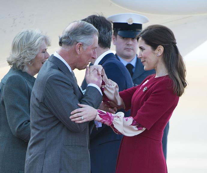 """Sealed with a kiss: Prince Charles greets [Crown Princess Mary of Denmark](https://www.nowtolove.com.au/tags/mary-crown-princess-of-denmark