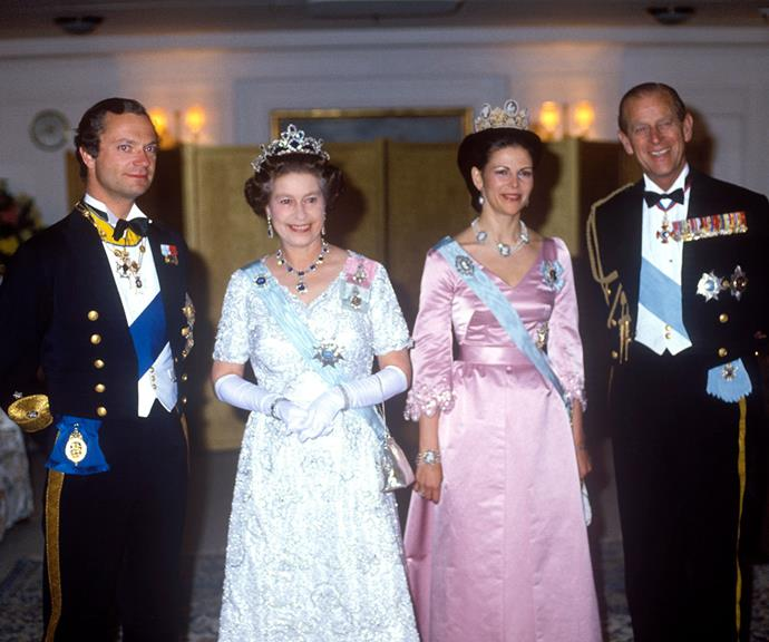 King Carl XVI Gustaf of Sweden, Queen Elizabeth, Queen Silvia of Sweden and Prince Philip are the epitome of old school glamour at a royal ball in 1983.