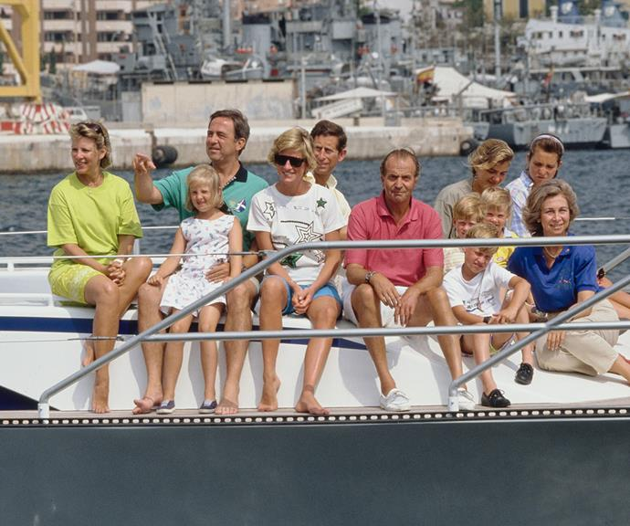 Three royal families unite: (L-R) Former Queen Anne-Marie and King Constantine of Greece with their daughter Princess Theodora, Princess Diana and Prince Charles, King Juan Carlos of Spain with his daughters Infanta Cristina and Infanta Elena, Prince William, Prince Harry and Queen Sofia of Spain relax on board a yacht during a holiday in Majorca, Spain in August 1990.