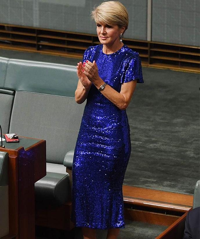 During her days as a politician Julie, pictured in a blue sequinned dress by Rachel Gilbert at the federal budget announcement, opted for a shorter pixie-style hairstyle.
