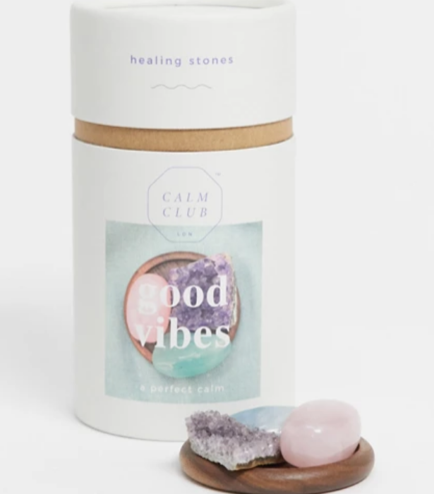 """Give the gift of good energy with these gorgeous crystals complete with wooden holder. <br><br>  *Calm Club good vibes relaxing crystal set, $40, [**shop it here.**](https://www.asos.com/au/calm-club/calm-club-good-vibes-relaxing-crystal-set/prd/14748042?colourwayid=16640845&SearchQuery=&cid=16095
