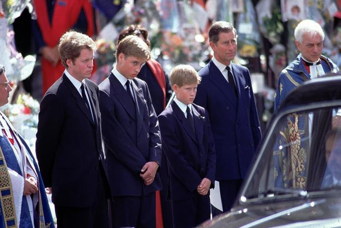 Charles with Diana's sons William and Harry at her funeral.