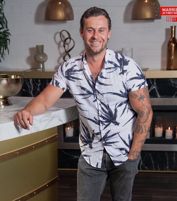 **Ryan Gallagher, season five**<br><br> He may not have to see his ex-wife Davina Rankin but Ryan is coming face-to-face with the guy she cheated on him with! <br><br> Since his *MAFS* experience in 2018, the tattooed tradie has also starred on the 2020 season of I'm A Celebrity Get Me Out Of Here and memorably hooked up briefly with *Geordie Shore* star, Charlotte Crosby.