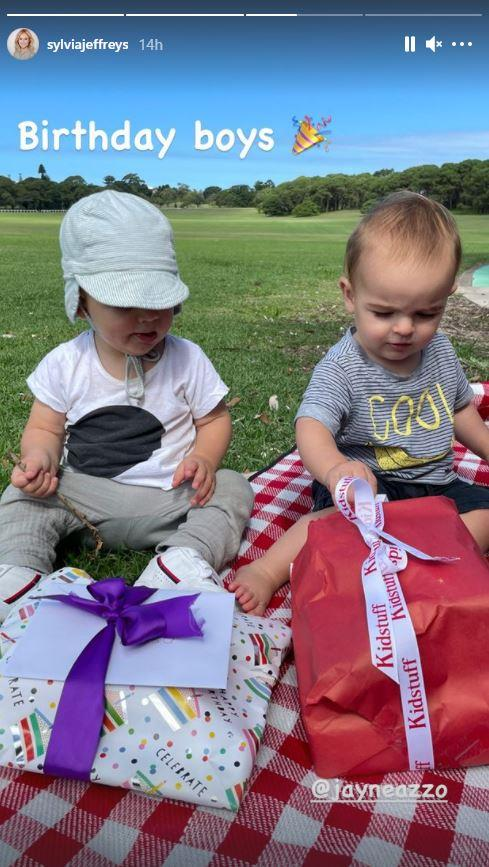 The TV presenters sons opened their first birthday presents together.