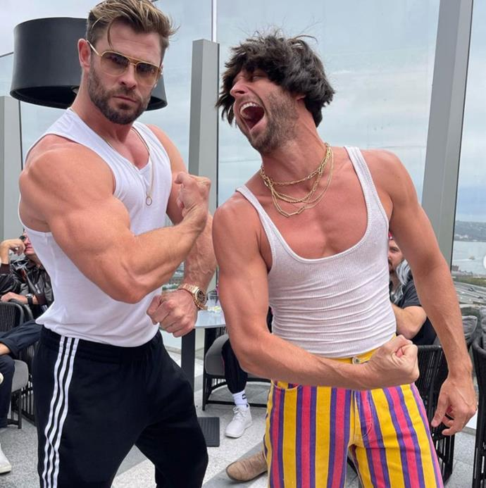 It's a muscle off between Chris and his personal assistant Aaron.