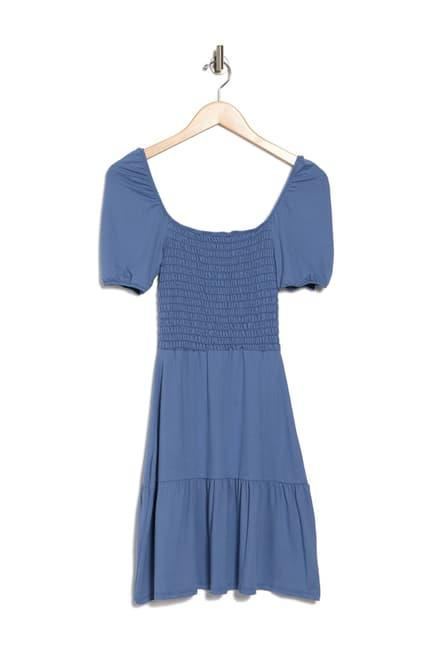 Meghan's dress was identified as Velvet Torch's Puff Sleeve Smocked Dress - a $38 steal.