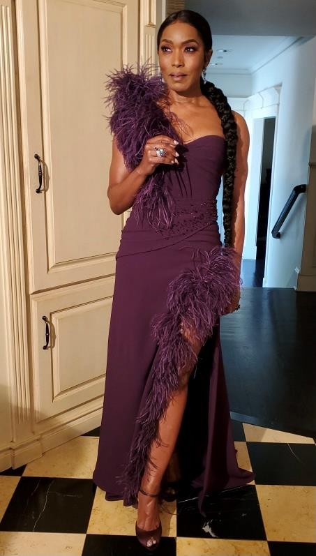 Actress Angela Bassett is purple perfection as she strikes a pose from home.