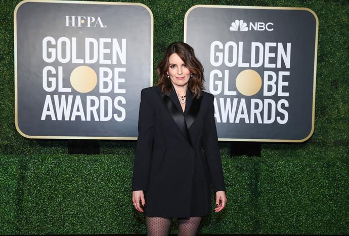 Over in New York, Amy's co-host Tina Fey also brought some dark glamour to the table in a black blazer ensemble.