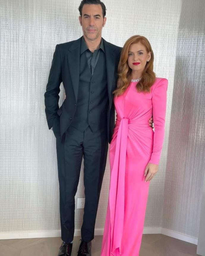 Aussie beauty Isla Fisher and her husband Sacha Baron Cohen were the image of glamour for the big day - Isla being a walking-talking example to prove red and pink *can* go together.