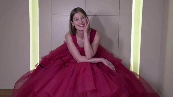 *Gone Girl*'s Rosamund Pike is chic in a bright red tulle-clad dress as she remotes in from home.