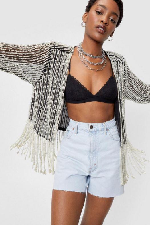 """A fringe jacket is a 70s staple as much as its a Mardi Gras party staple - look no further than this Nasty Gal pearl inspired style, $142. **[Buy it online here](https://www.nastygal.com/au/fringe-pearl-inspired-beaded-open-front-jacket/AGG40959.html