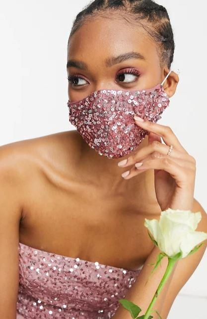"""If you're wanting to glam up your mask game, let this Maya sequin design be the perfectly timed addition to your Mardi Gras ensemble, $18. **[Buy it online here](https://www.asos.com/au/maya/maya-sequin-face-covering-in-rose/prd/22892594