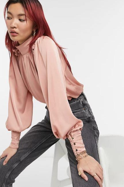 """River Island ruched satin high-neck blouse in pink, $64. **[Buy it online via ASOS here](https://www.asos.com/au/river-island/river-island-ruched-satin-high-neck-blouse-in-pink/prd/21764128