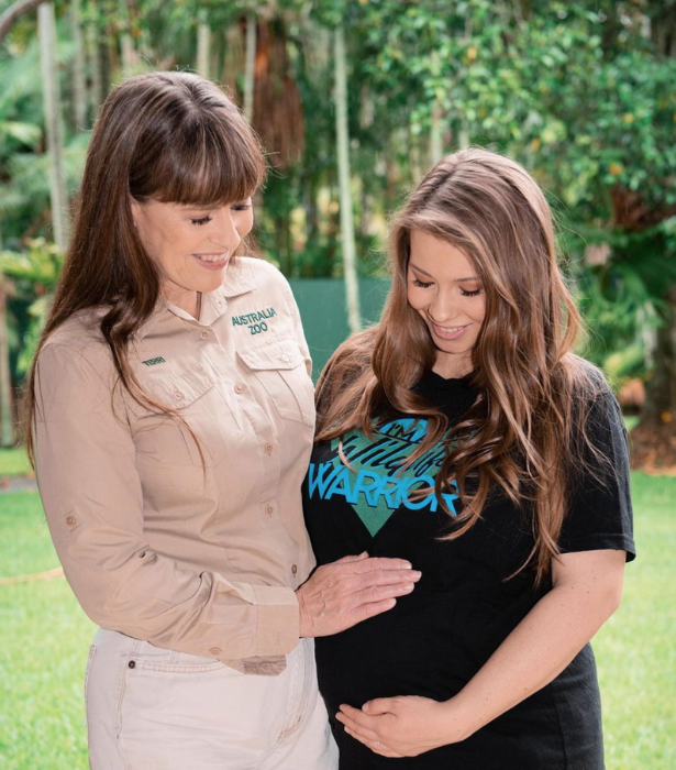 """**Bindi Irwin**<br> <br>  Three generations of incredible Irwin women!  <br> <br>  """"Here's to strong women. May we know them. May we be them. May we raise them,"""" Bindi wrote in a pic cradling her growing bump with mum Terri Irwin by her side."""
