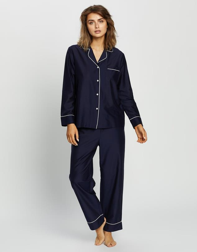 """Or if you're after something a little more covered up, this Papinelle navy set is also a winner. $149.95, **[buy it online via The Iconic here](https://www.theiconic.com.au/mia-luxe-pj-set-1169200.html target=""""_blank"""" rel=""""nofollow"""")**"""