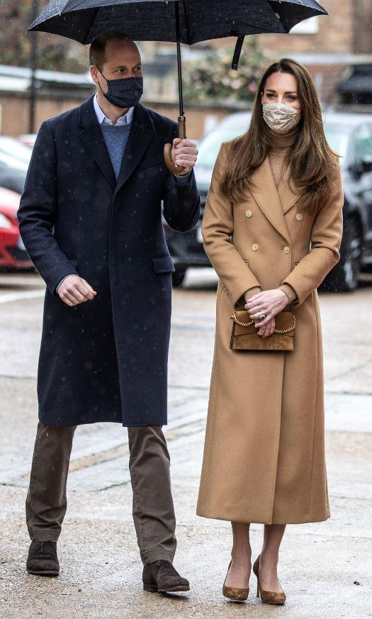 Kate looked ultra chic in a brown coat by Massimo Dutti.