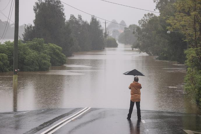 A man surveys floods in McGraths Hill, New South Wales.