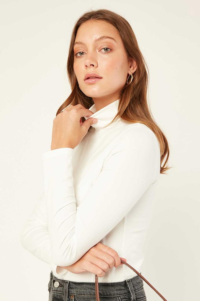 "L&T Essential Turtleneck Top in White, $25 (on sale). **[Buy it online via Universal Store here](https://www.universalstore.com/l-t-essential-turtleneck-top-white.html4|target=""_blank""|rel=""nofollow"")**"