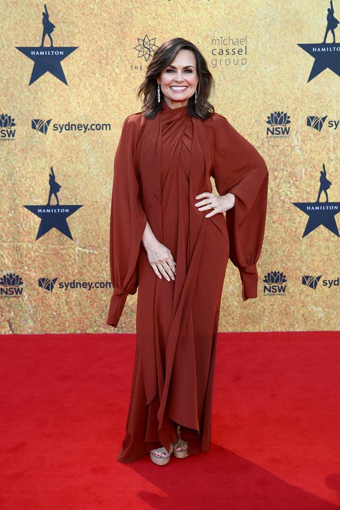 Lisa Wilkinson looked stunning in a long-sleeved gown with draping detail.