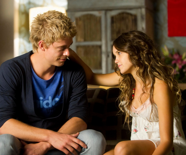 **Luke Mitchell:** Romeo Smith (2009 - 2013) <br><br> **THEN:** Yep, Luke and Rebecca fell in love on-set of *Home and Away* during their several-year stint on the show. Playing character Romeo, the gentle-hearted surfer ran the Surf Club gym before being diagnosed with stage four cancer - he quietly left Summer Bay in order to spend his last months away from his nearest and dearest for fear of them having to watch him suffer.