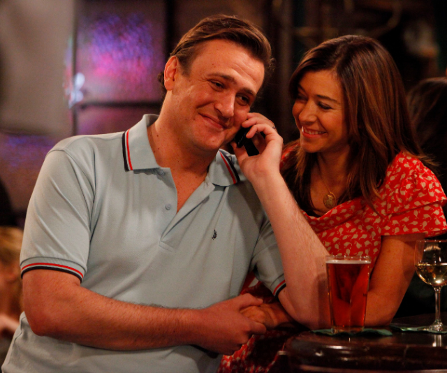 """**Marshall and Lily – How I Met Your Mother**<br><br> Lily and Marshall didn't know what it was to be apart, which admittedly isn't a healthy relationship IRL, but in TV land it makes for icon-status. <br><br> Marsh-mellow and Lily-pad are the kind of couple we all aspire to be, albeit slightly less """"blob"""" like; perfectly in-tune, frank and open and still hanging out with their friends despite being coupled up. <br><br> As many couples who fall in love young do, Lily began to doubt whether she'd lived her life to the fullest having been tied down by monogamy, and ran off to San Francisco to pursue her dream. <br><br> Luckily for fans, the couple realized that antiquated idea that you can't be free and live your best life while in a couple, was just that; outdated and false."""