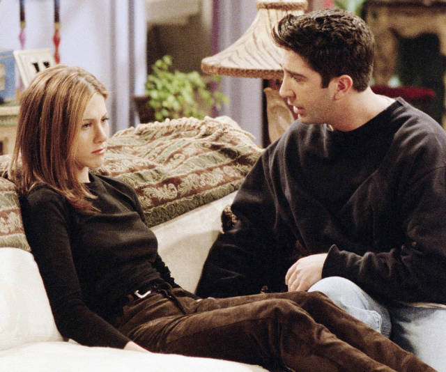 """**Ross and Rachel – Friends** <br><br> It only took a season and a half for Ross (David Schwimmer) and Rachel (Jennifer Aniston) to get together, but like most couples, they faced some challenges in their relationship. <br><br> As we watched the couple struggle through their first serious breakup and the infamous """"we were on a break"""" debate, our hearts ached for them, both clearly in pain. <br><br> They were destined for one another however, when Rachel burst through Ross' door in the series finale and muttered those iconic words """"I got off the plane"""", we had chills that lasted for days."""