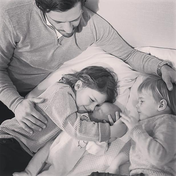 The adorable second image showed the boys embracing their new little brother.