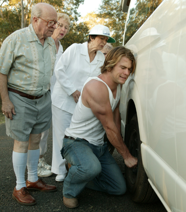 Proving the ultimate gentleman and changing a tire for the elderly is something we can see Chris doing too.