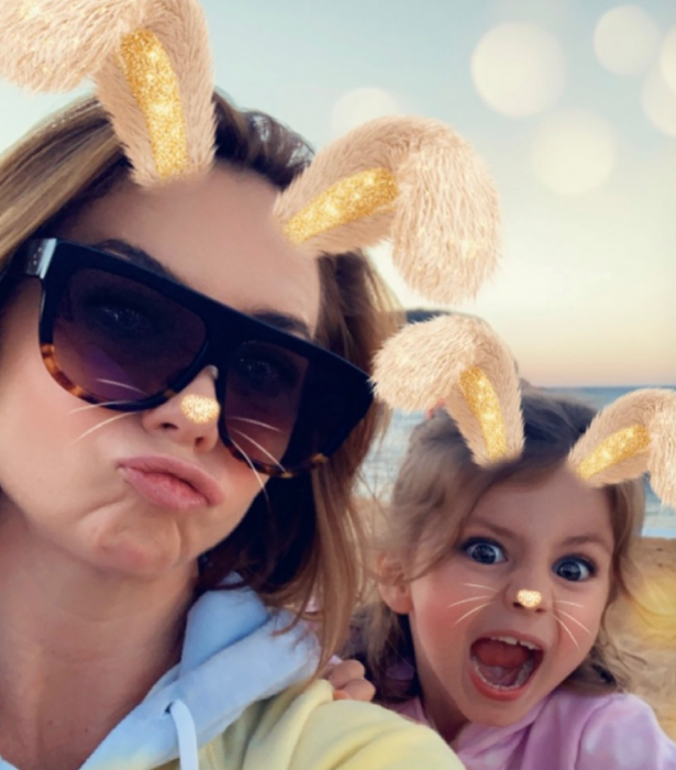 """**Kate Ritchie** <br><br>  Who needs costume bunny ears when you have photo filters! We just adore this snap of beach bunnies [Kate and her mini-me daughter Mae.](https://www.nowtolove.com.au/parenting/celebrity-families/kate-ritchie-daughter-63685 target=""""_blank"""")"""