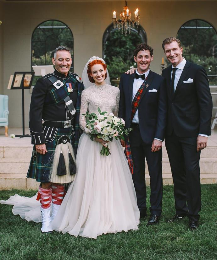 "The musical stars, pictured with their bandmates, said ""I do"" in front of 200 close friends and family. Emma looked radiant in an elegant ivory vintage-meets contemporary gown by Australian designer Suzanne Harward. The Wiggles beauty completed the look with a diamond headpiece by milliner Viktoria Novak."