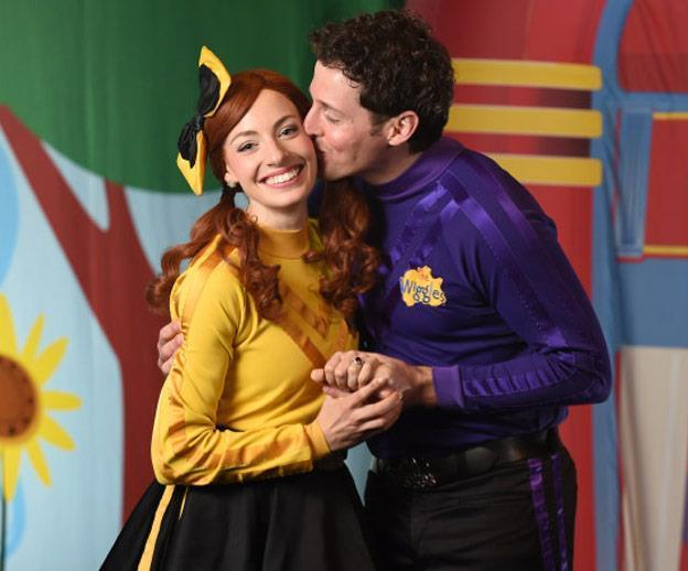 A loved-up Emma and Lachy pose on the set of The Wiggles with the Yellow Wiggles' ruby red engagement ring taking centre stage.
